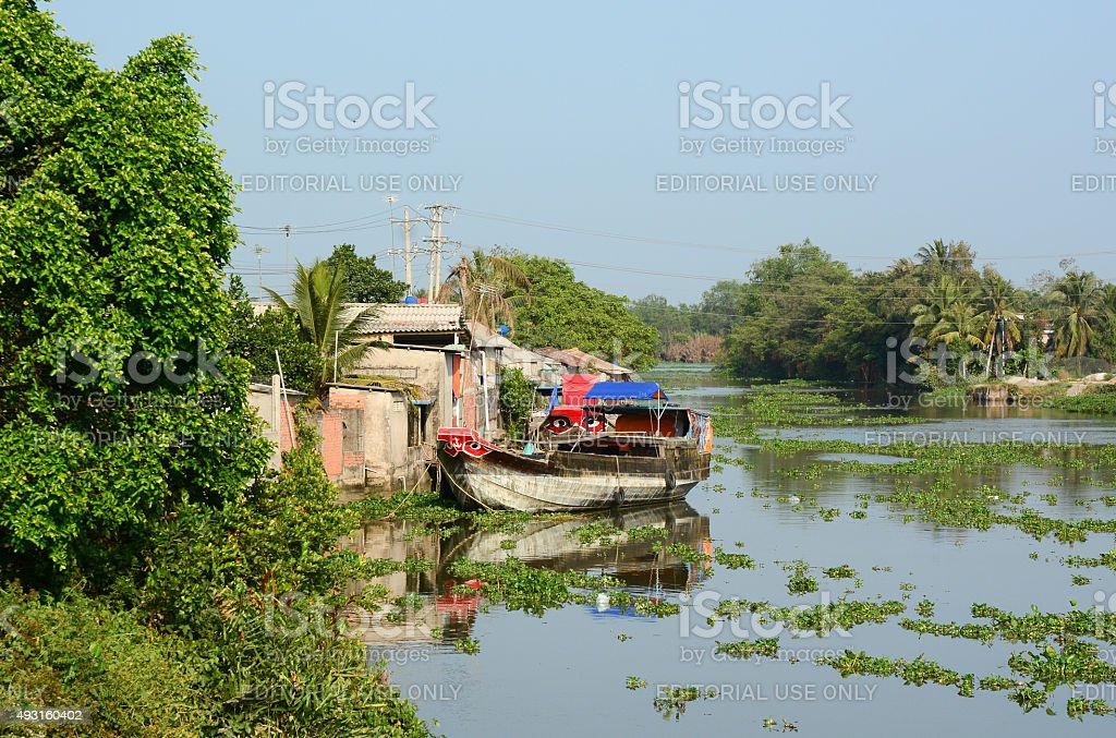 View of the river with cargo boats in Vietnam stock photo