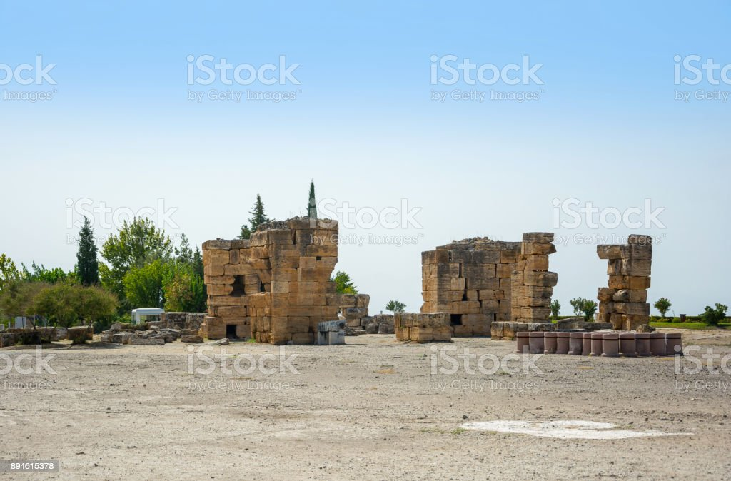 View of the ruins of the city of Hierapolis, modern name of the location - Pamukkale, Turkey. stock photo