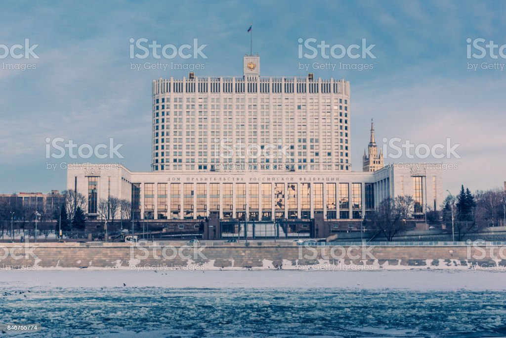 View of the Russian Government House and the frozen river in winter stock photo
