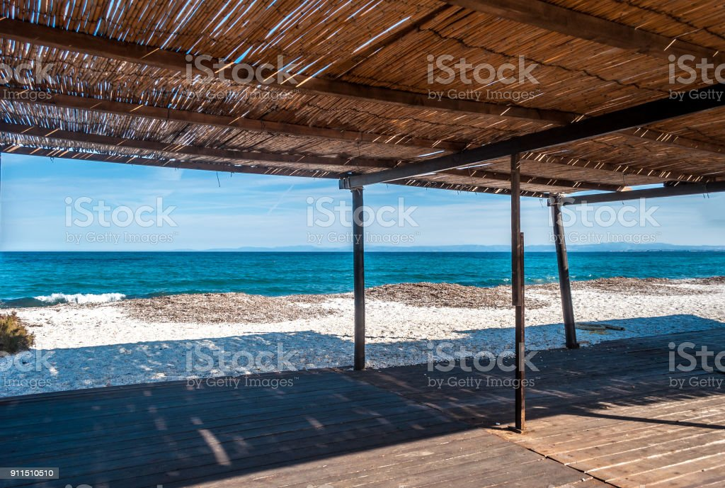 View of the sea from a reed gazebo stock photo