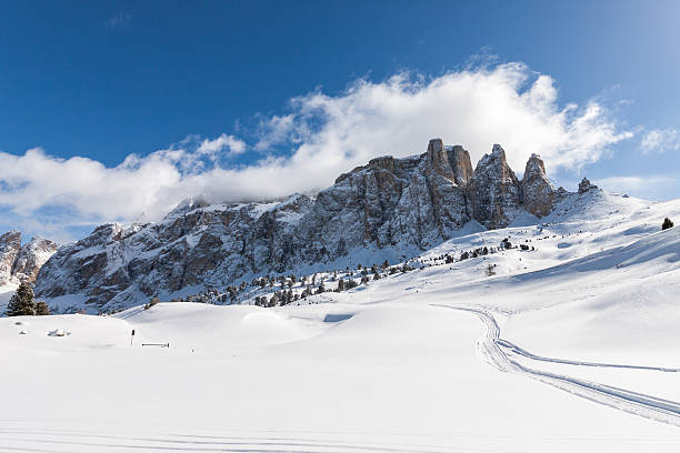 View of the Sella Group in the Italian Dolomites View of the Sella Group with snow in the Italian Dolomites trentino alto adige stock pictures, royalty-free photos & images
