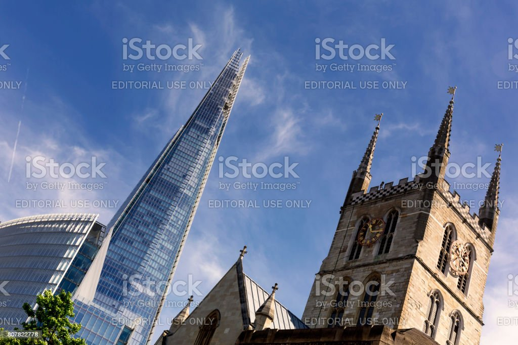 View of the Shard London Bridge and the Southwark Cathedral at day stock photo