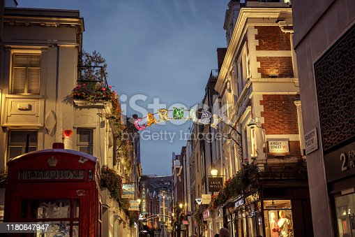 View of the shops and restaurants of Carnaby Street in London at night