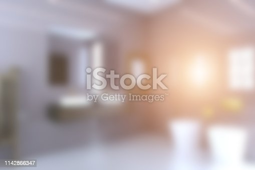 View of the sink, toilet and bidet in a large modern bathroom with brown doors.. Sunset. 3D rendering. Unfocused