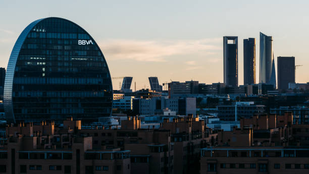 View of the skyline of Madrid with Las Tablas residential district, BBVA office building and Cuatro Torres financial district at sunset. stock photo