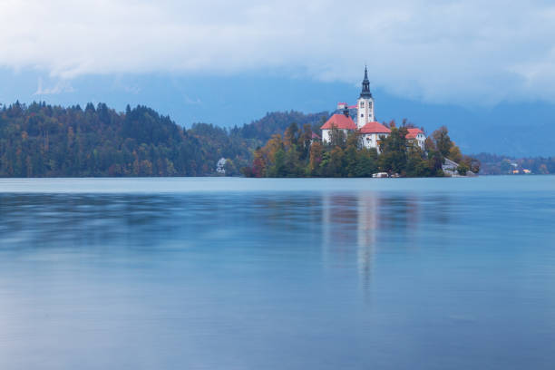 View of the small island on lake Bled in Slovenia with the Pilgrimage Church of the Assumption of Maria stock photo