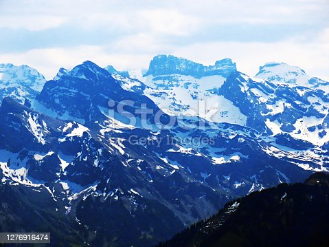 View of the snowy peaks and glaciers of the Swiss Alps from the Pilatus mountain range in the Emmental Alps, Alpnach - Canton of Obwalden, Switzerland (Kanton Obwald, Schweiz)
