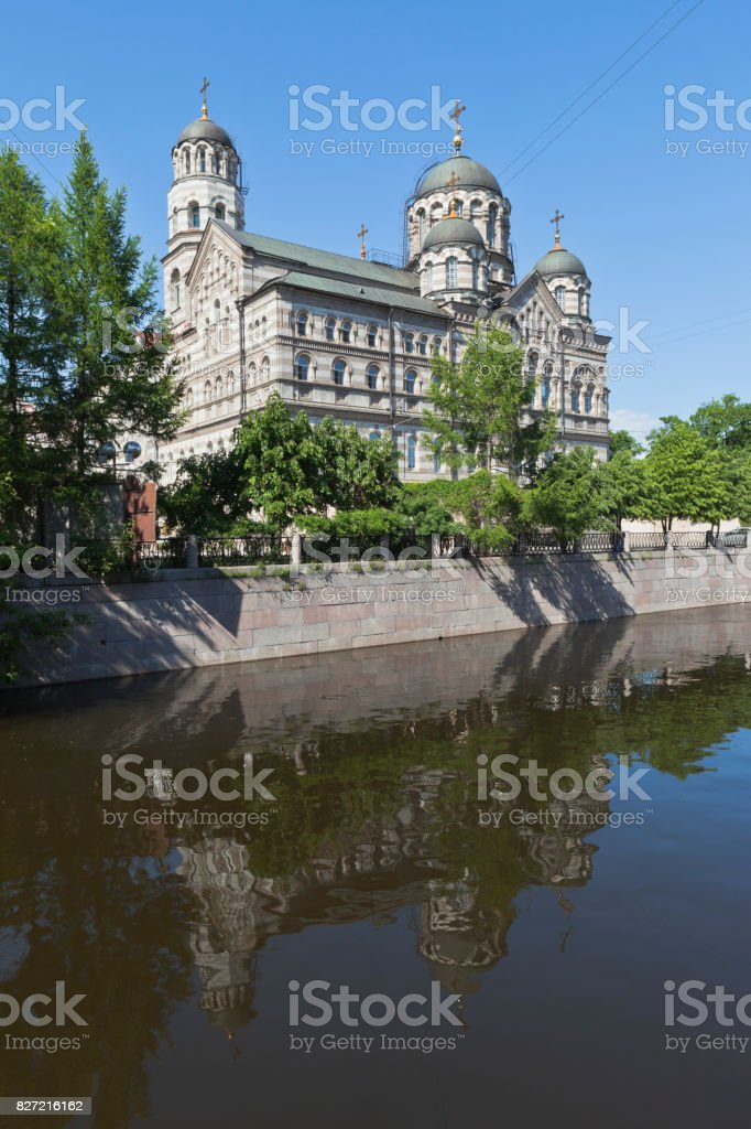 View of the St. John's Stauropegial Convent with a reflection in the river Karpovka stock photo