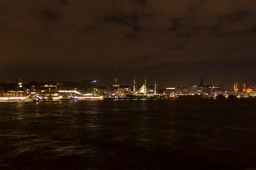 View of the St. Pauli Piers by night, one of Hamburg's major tourist attractions. Hamburg, Germany.