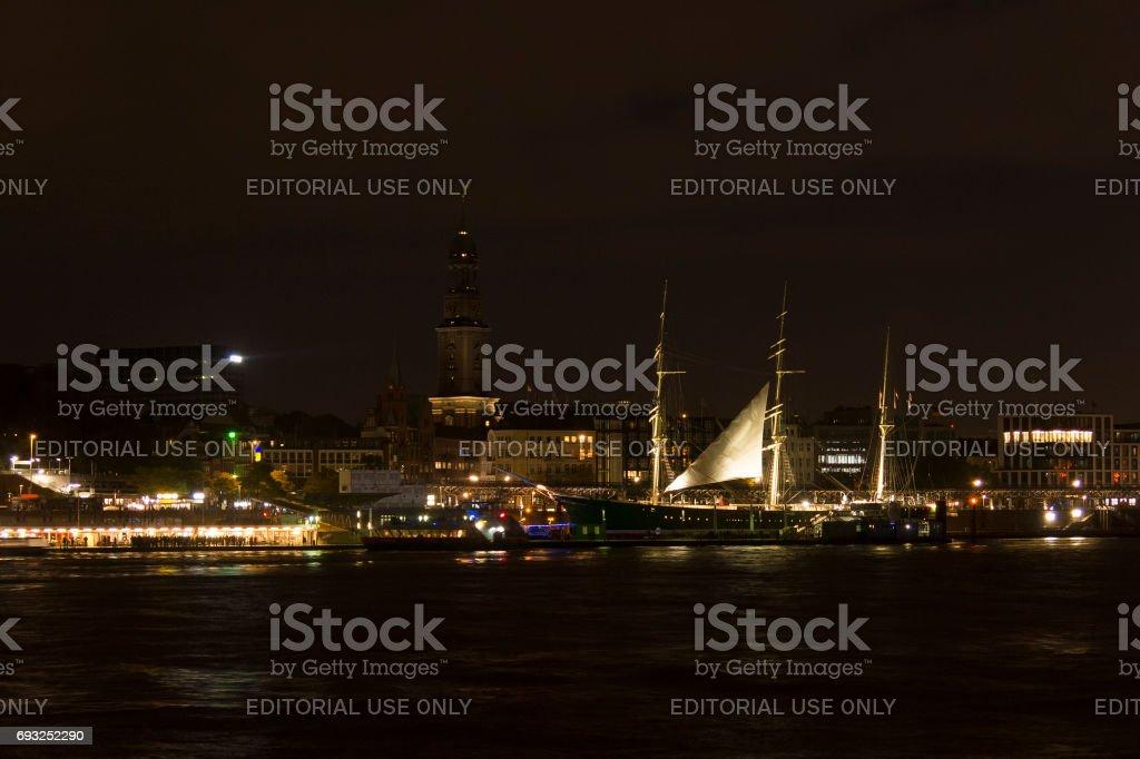 View of the St. Pauli Piers by night, one of Hamburg's major tourist attractions. Hamburg, Germany. stock photo