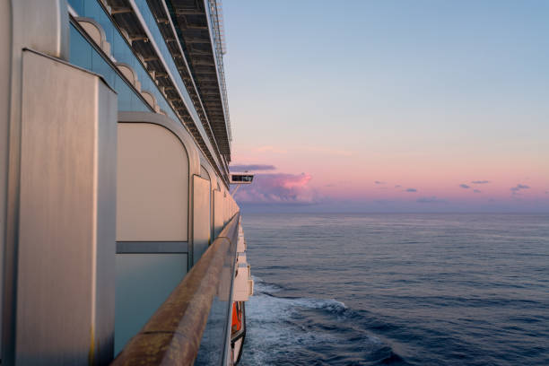 View of the starboard side of a cruise ship at sunset in the Caribbean Sea. stock photo