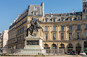 View of the Statue of Louis XIV located at Place des Victoires near to the Palais Royale in Paris city, France.
