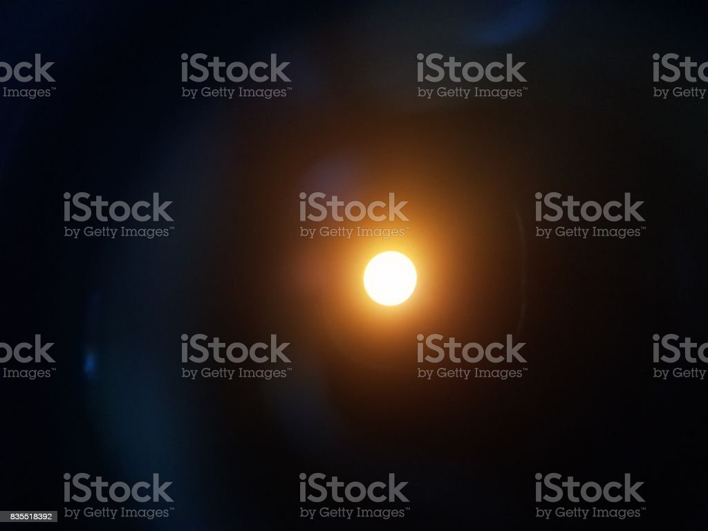 view of the sun through solar filter and binoculars stock photo