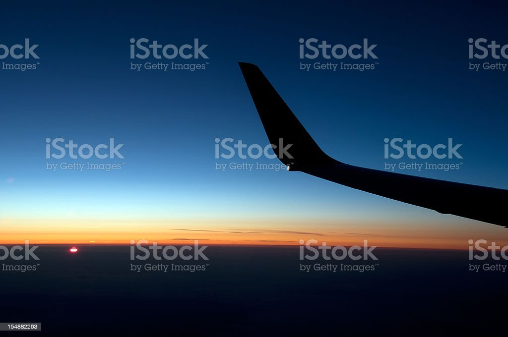 View of the sunrise out an airplane window stock photo