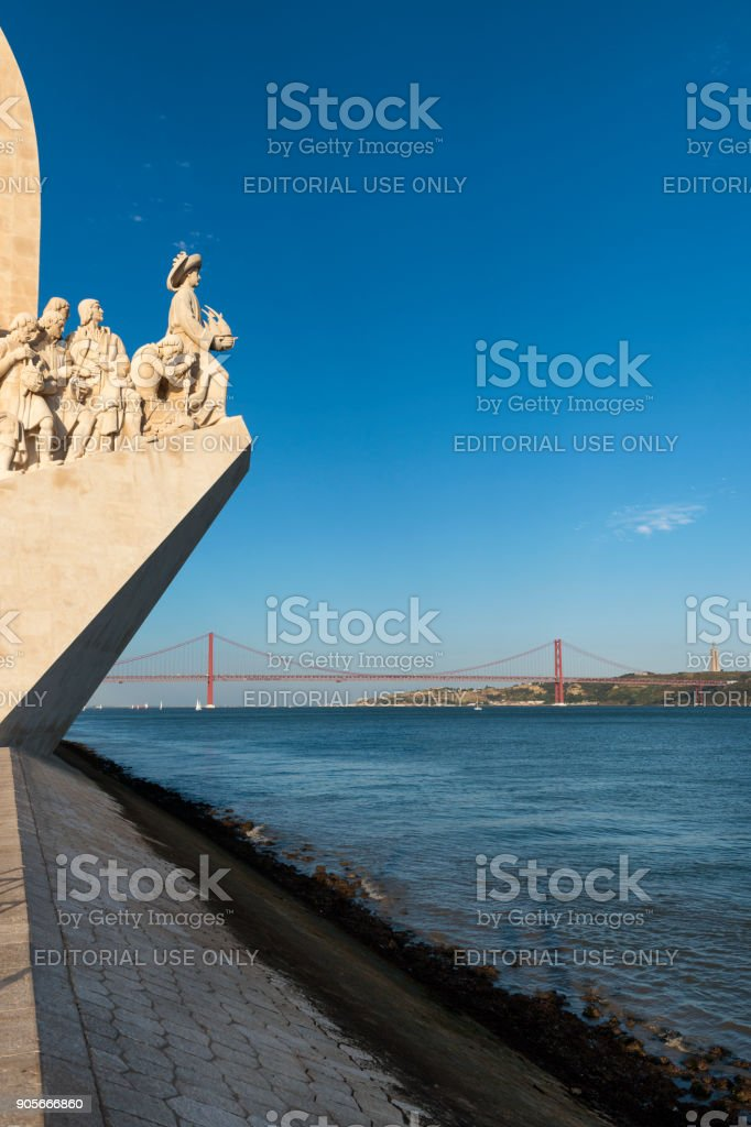 View of the Tagus River in Lisbon with the Monument to the Discoveries (Padrao dos Descobrimentos) and the 25 of April Bridge on the background stock photo