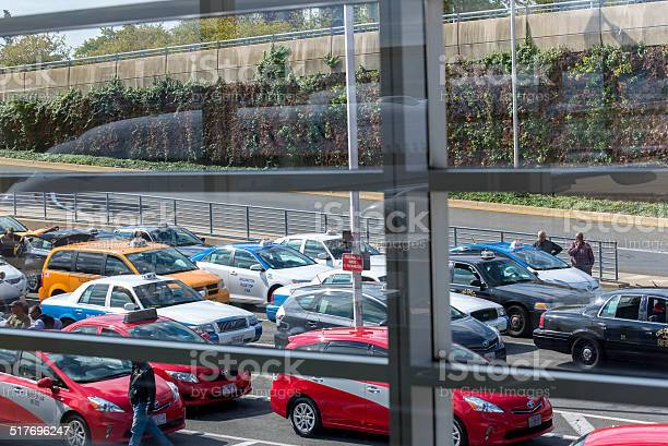 View of the taxi line out an airport window Washington, DC, United States - October 4, 2014: DCA, Reagan National Airport, Washington, DC - View out airport window to airplanes and ramp operations Airport Stock Photo