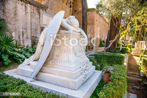 Rome, Italy, February 20 -- A view of the non-Catholic cemetery in Rome, built between the 18th and 19th centuries, where illustrious Italian people find rest but mainly foreigners, such as the British poets Percy Bysshe Shelley and John Keats, among the greatest representatives of romanticism. In the photo the beautiful tomb of the American sculptor William Wetmore Story, where he rests with his wife Emelyn and his son Josep. Above his grave is The Angel of Grief, which depicts a groaning angel lying on the tomb, made by William Wetmore Story himself shortly before he died in 1895. Image in HD format.
