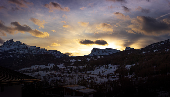 A view of the town with Mount Ra Gusela and Averau at sunset, in Cortina d'Ampezzo, Italy
