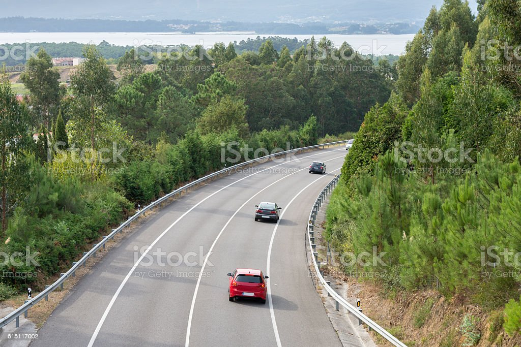 view of the turn of the highway between the mountains stock photo