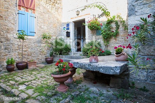 istock View of the typical Istrian courtyard, Groznjan 1252842847