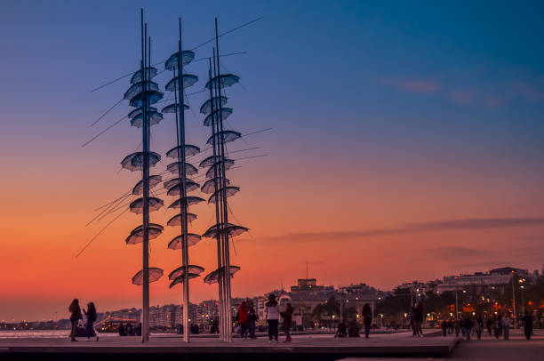 """View of the """"Umbrellas"""" sculpture  created in 1997 by the sculptor Georgios Zoggolopoulos, located at the seafront of the city. stock photo"""
