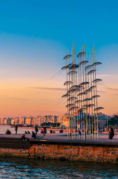 View of the Umbrellas sculpture located at the seafront of the city. stock photo