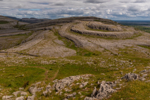 a view of the unique sliabh rua, red mountain from mullaghmore mountain in the burren national park - the burren stock pictures, royalty-free photos & images