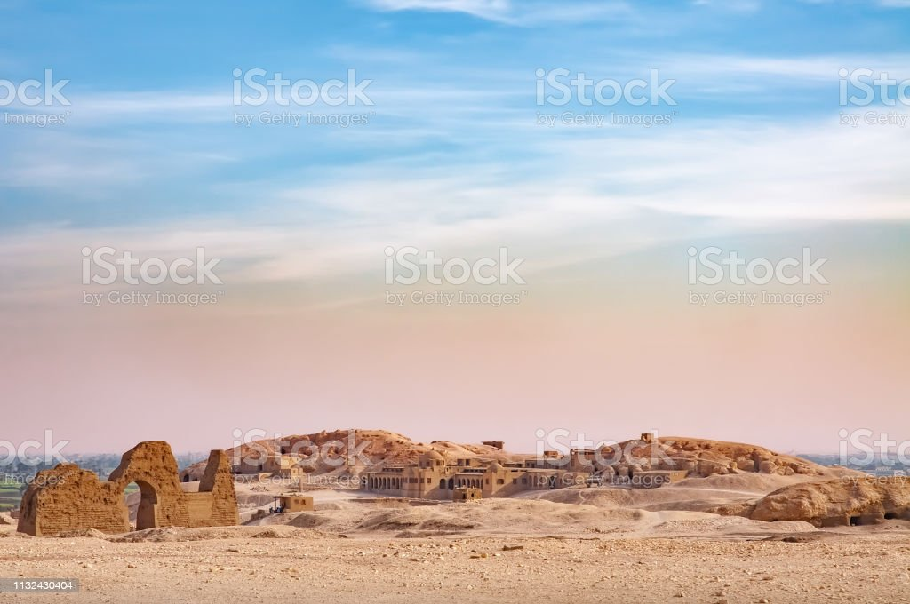 View of the Valley of the Kings View of  the Valley of the Kings in Egypt, with a blue and pink sky over the desert Africa Stock Photo