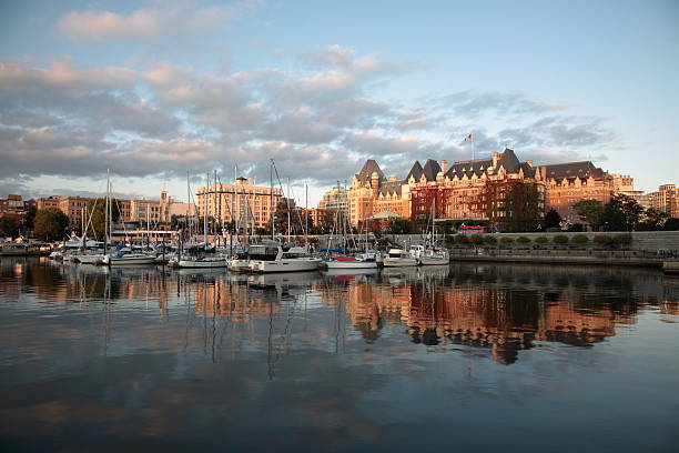 a view of the victoria harbor at sunset - british columbia stock pictures, royalty-free photos & images