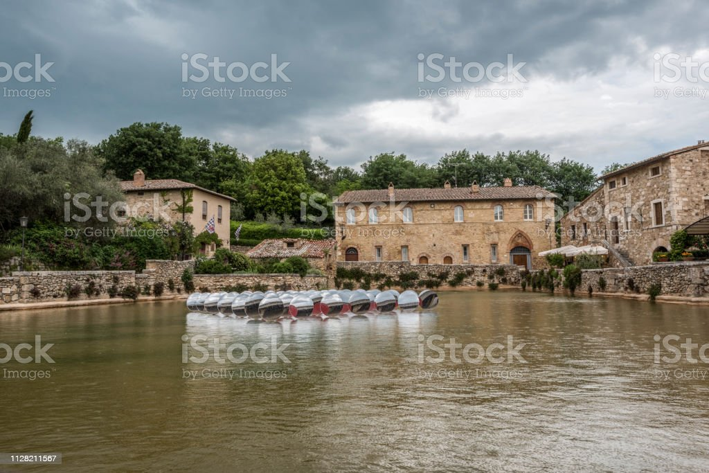View of the village of Bagno Vignoni from the pool of thermal waters stock photo