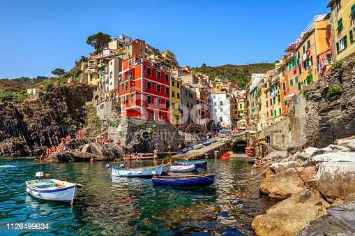 View of the village Riomaggiore. Cinque Terre National Park, at summer with tourists in Liguria Italy