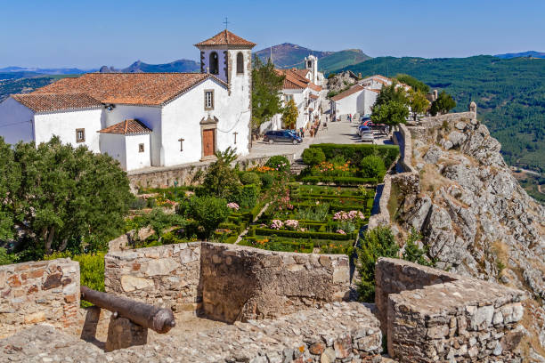 view of the village, santa maria church and garden from the castle tower. - fotos de portalegre imagens e fotografias de stock