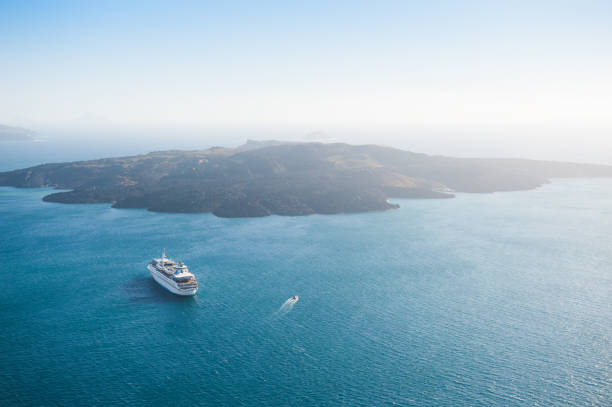 view of the volcano near santorini island, greece. - cruise ship stock photos and pictures