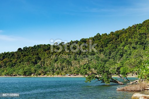 View of the White Sand Beach, Chang island,Thailand. Unidentified tourists enjoying their holidays on Thai beach at hot summer day