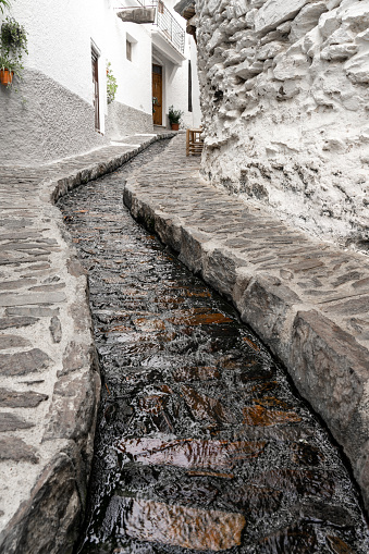 Pampaneira, Granada - September 01, 2020: View of the white streets of the village of Pampaneira in the Alpujarra Region. Granada, Andalucia, Spain