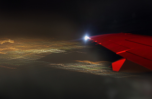 View Of The Wing Of The Plane From The Window Night Outside The