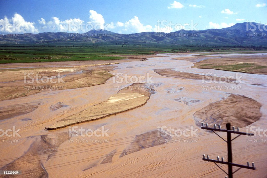 View of the Yellow river from railroad bridge and braided stream pattern near Hohhot Inner Mongolia China stock photo