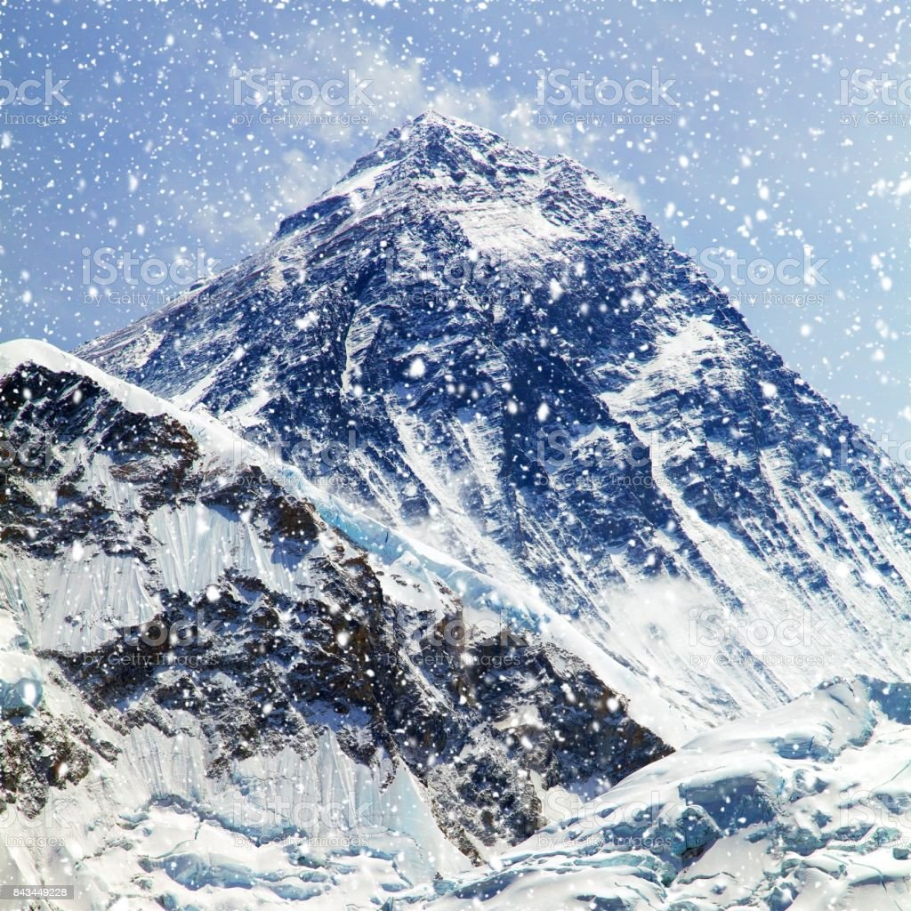 View of top of Mount Everest with clouds and snowfall stock photo