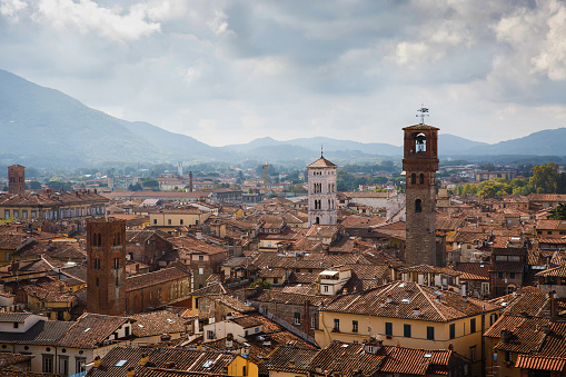 istock View of Torre Delle Ore from top of Guinigi Tower, Lucca, Tuscany, Italy. Scenic city panoramic overview picturesque travel postcard. 995119594