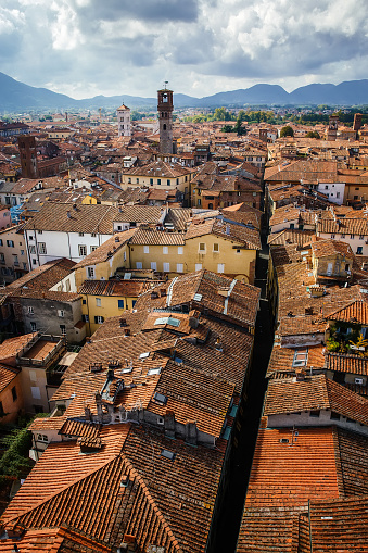 istock View of Torre Delle Ore from top of Guinigi Tower, Lucca, Tuscany, Italy. Scenic city panoramic overview picturesque travel vertical postcard. 995119610