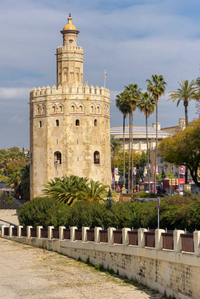 View of Tower of Gold in Seville, a popular tourist destination next to Guadalquivir river. - foto stock