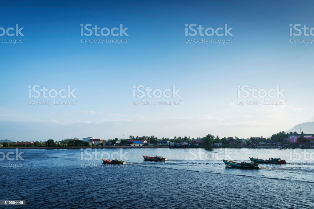view of traditional fishing boats on kampot river in cambodia stock photo
