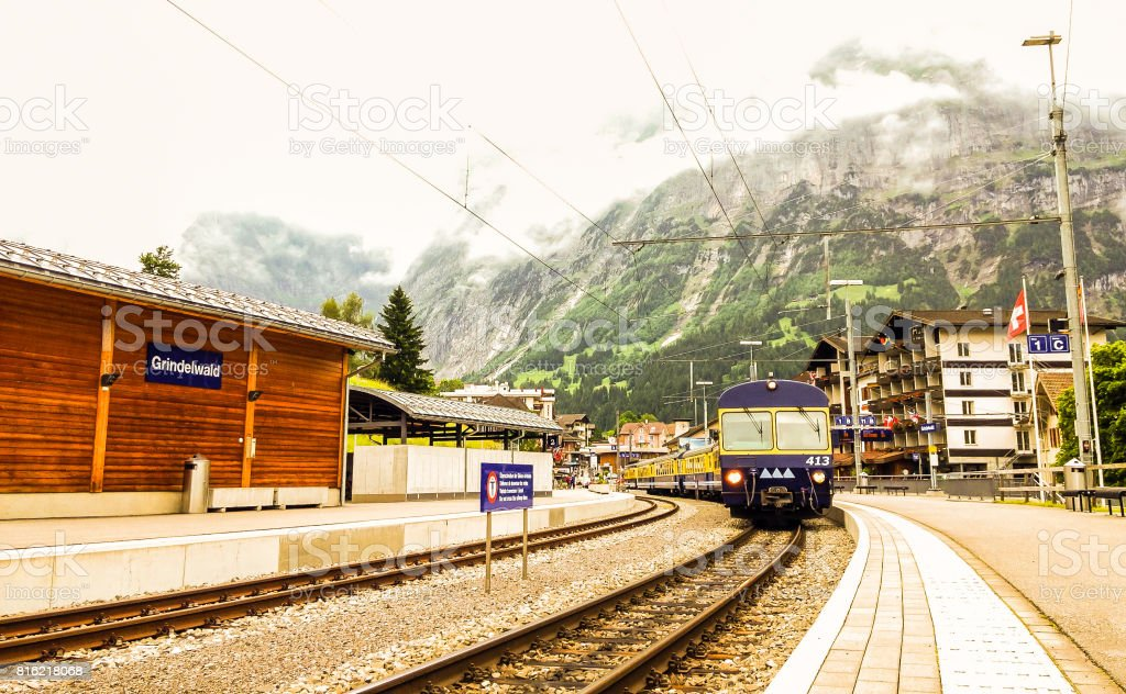 View of train from Grindelwald train station in swiss alpine Jungfrau region, Grindelwald, Bernese Oberland, Bern Canton, Switzerland, Europe. stock photo