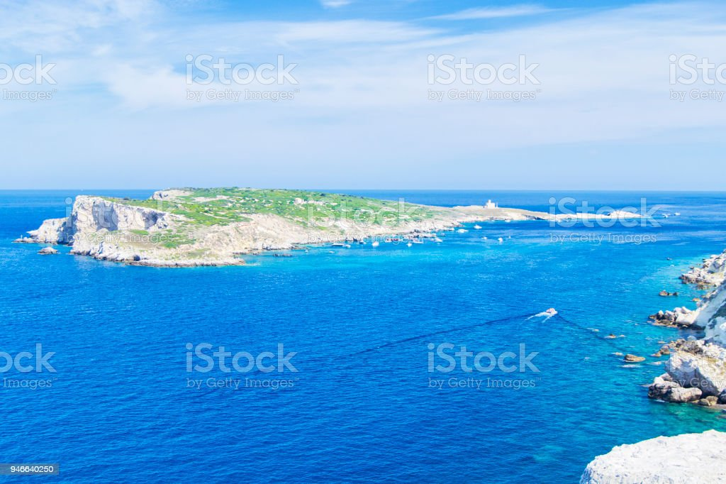 view of Tremiti islands with blue water, boats and clouds. Gargano. Puglia, Italy. stock photo