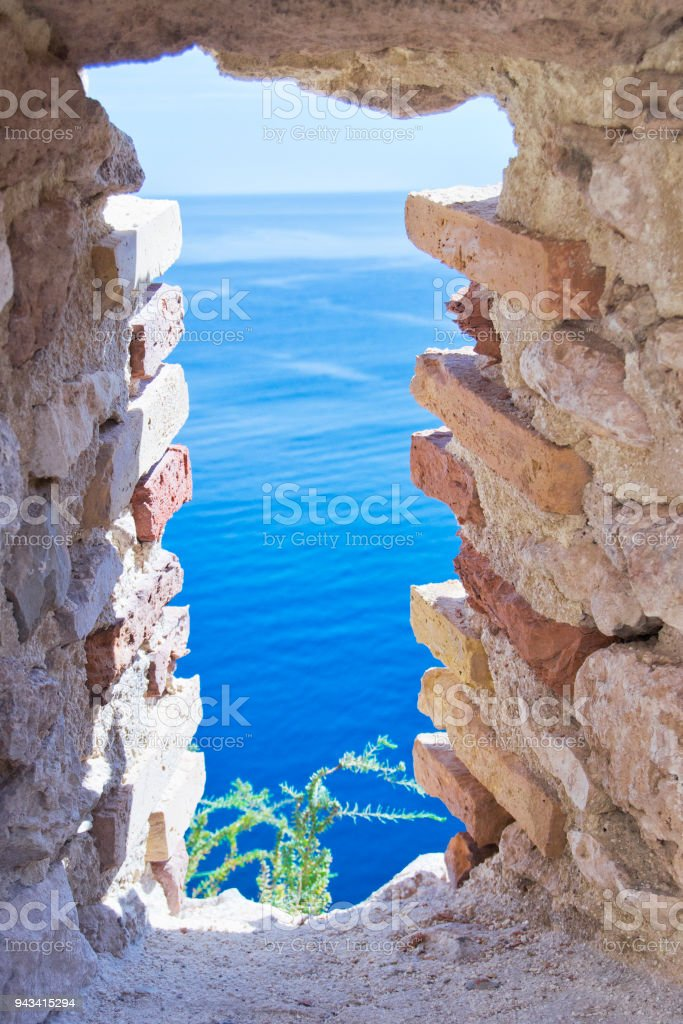 view of Tremiti islands with blue water, boats and clouds. stock photo