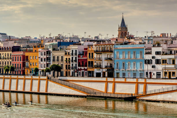 View of Triana in Seville, Spain. View of colorful homes in picturesque Triana neighborhood in Seville, Spain. seville stock pictures, royalty-free photos & images