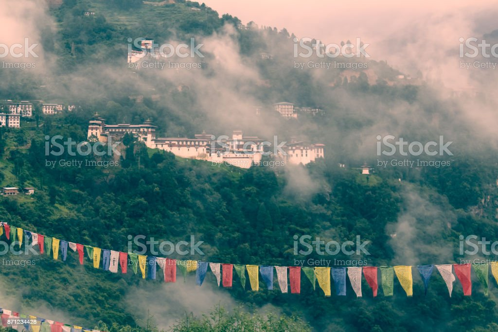 View of Trongsa Dzong and Ta-Dzong with foggy hills, Bumthang, Bhutan, Asia. stock photo