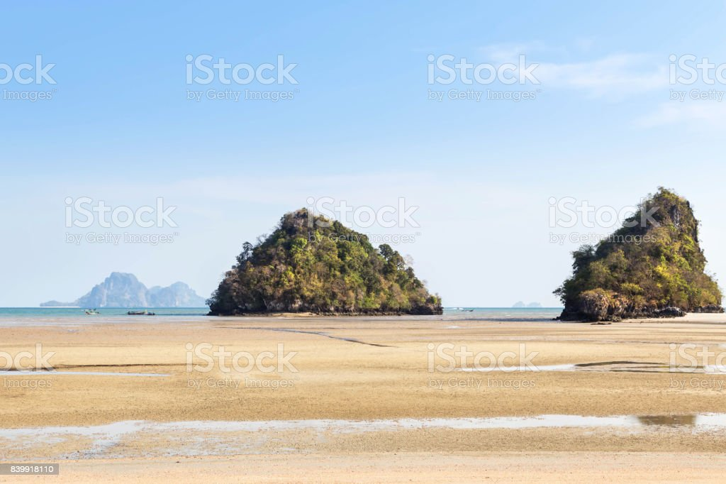 view of tropical beach during low tide at Ao Nang beach Krabi, Thailand. stock photo