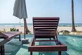 View of empty tropical beach from deck chair