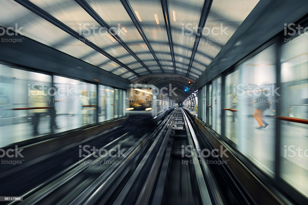View of Turin metro tracks, with people waiting outside stock photo